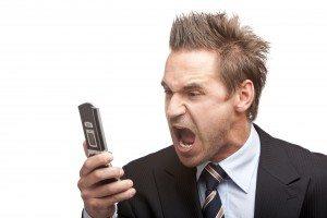 Businessman stressed by mobile phone, The Myndset Digital Marketing